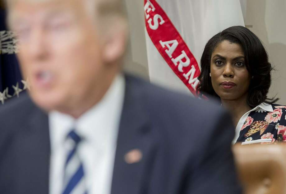 This file photo taken on February 14, 2017 shows Omarosa Manigault (right), White House Director of Communications for the Office of Public Liaison, sitting behind US President Donald Trump as he speaks during a meeting with teachers, school administrators and parents in the Roosevelt Room of the White House in Washington, DC.  Photo: SAUL LOEB, AFP/Getty Images