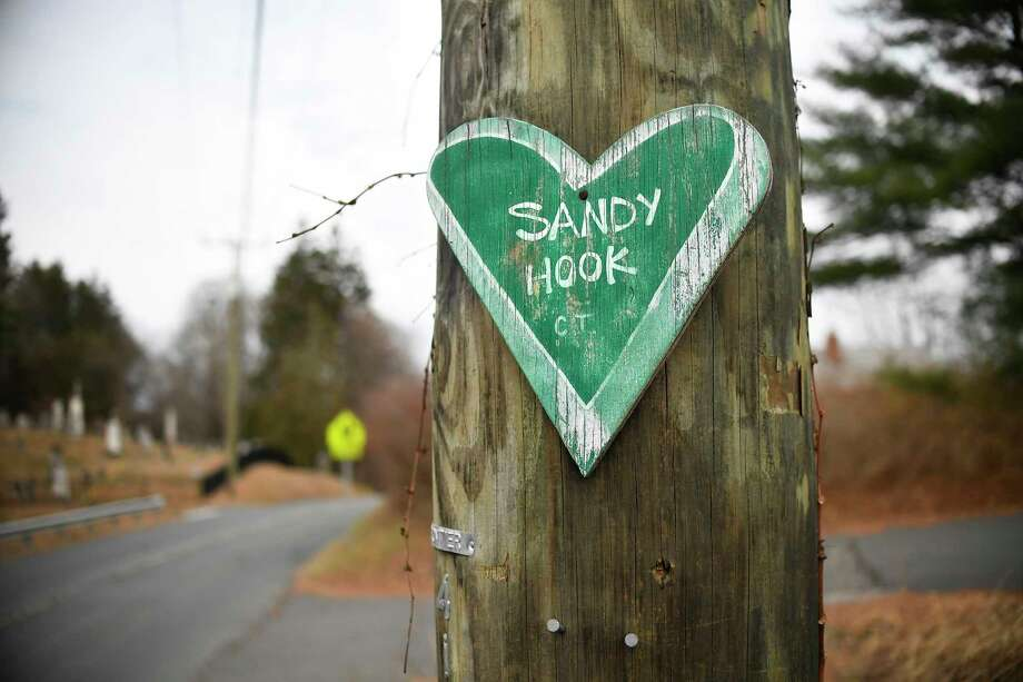 The Sandy Hook massacre killed 20 children and six adults. Photo: JESSICA HILL, STR / NYTNS