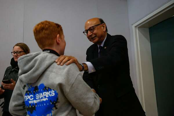 Khizr Khan (center,right), the Muslim-American Gold Star father embraces Hayden Abbott,13, after speaking at Hall Middle School in Larkspur, Calif., on Wednesday, Dec. 6, 2017.