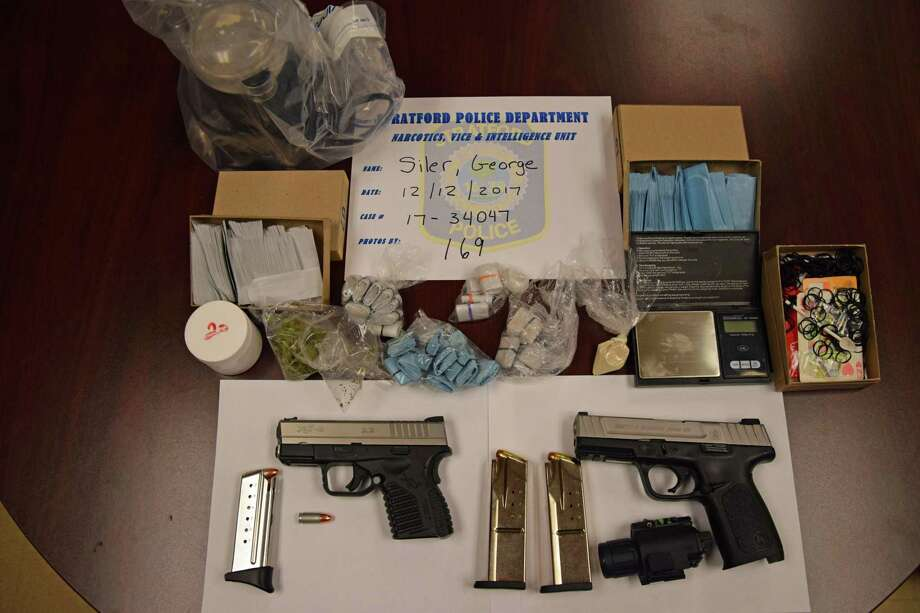 Police in Stratford, Conn., charged George Siler, 27, of Stratford, with operating a drug factory, sale of narcotics, sale of narcotics within 1,500 feet of a daycare, illegal transfer of a firearm, obliterated serial number, theft of a firearm, two counts criminal possession of a firearm and criminal possession of ammunition on Dec. 12, 2017. Photo: Contributed Photo / Stratford Police Department / Contributed Photo / Connecticut Post Contributed