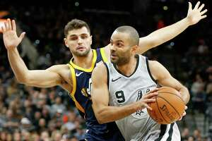 San Antonio Spurs' Tony Parker drives around Utah Jazz's Raul Neto during first half action Saturday Feb. 3, 2018 at the AT&T Center.