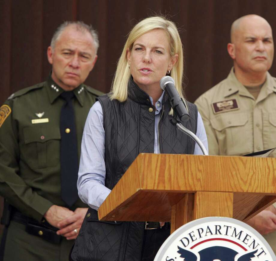 United States Department of Homeland Security Secretary Kirstjen Nielsen speaks to the local news media against the backdrop of the border wall, Wednesday, Dec 13, 2017, in Hidalgo, Texas. The new head of the U.S. Department of Homeland Security says she hopes construction on a border wall will begin soon. (Joel Martinez/The Monitor via AP) Photo: Joel Martinez, MBI / Associated Press / The Monitor
