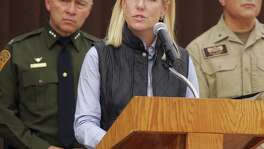 United States Department of Homeland Security Secretary Kirstjen Nielsen speaks to the local news media against the backdrop of the border wall, Wednesday, Dec 13, 2017, in Hidalgo, Texas. The new head of the U.S. Department of Homeland Security says she hopes construction on a border wall will begin soon. (Joel Martinez/The Monitor via AP)