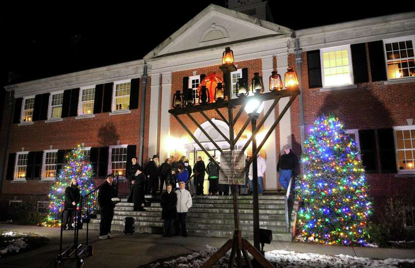 The Mishkan Day Camp of North Stamford holds its 28th annual Lighting of the Menorah in front of the Trumbull Town Hall Steps to celebrate Hanukkah in Trumbull, Conn. on Wednesday Dec. 13, 2017. Mishkan Israel Day Camp was opened in Bridgeport in 1945 under the direction of rabbi Israel Stock and his wife. It branched out to include Stamford and other Fairfield County communities in 1975.