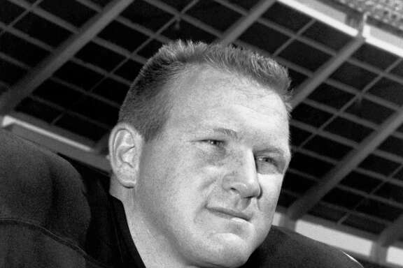 FILE - In this Dec. 13, 1966, file photo, Tommy Nobis of the Atlanta Falcons poses. Nobis, the first player ever drafted by Atlanta in 1966 and a hard-hitting linebacker who went on to spent his entire 11-year career with the team, died Wednesday, Dec. 13, 2017, after an extended illness, the team announced. He was 74. (AP Photo/File)