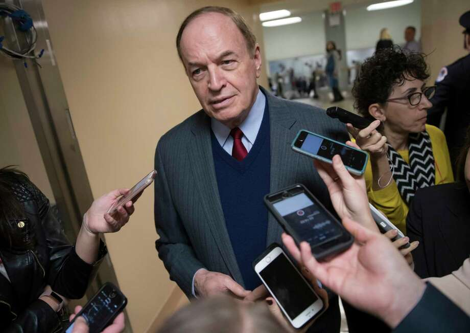 Reporters seek a comment from Sen. Richard Shelby, R-Ala., a critic of Alabama Republican Roy Moore who is running for the Senate in a special election, on Capitol Hill in Washington, Tuesday, Dec. 12, 2017. (AP Photo/J. Scott Applewhite) ORG XMIT: DCSA123 Photo: J. Scott Applewhite / Copyright 2017 The Associated Press. All rights reserved.