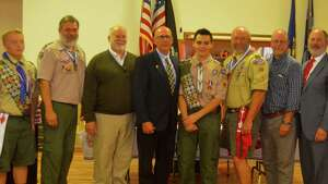 Eagle Scouts turn out for Hudson Boy Scout Troop 102 Eagle Scout ceremony for Noah Wurster. From left are Eagle Scouts Bill Shaughnasey, Connor McCagg, Steve Krizar, William R. Slemp, Peter M. Wurster, Noah Wurster, Ed Coons, Dave Fabiano, Rich Koweek, Ed Gower. The unusual gathering is due in large part to Noah?s father, Peter, who earned his own Eagle Scout in the 1970s, remaining active in scouting, and the large number of Eagle Scouts Troop 102 has produced over the years. (Mike McCagg)