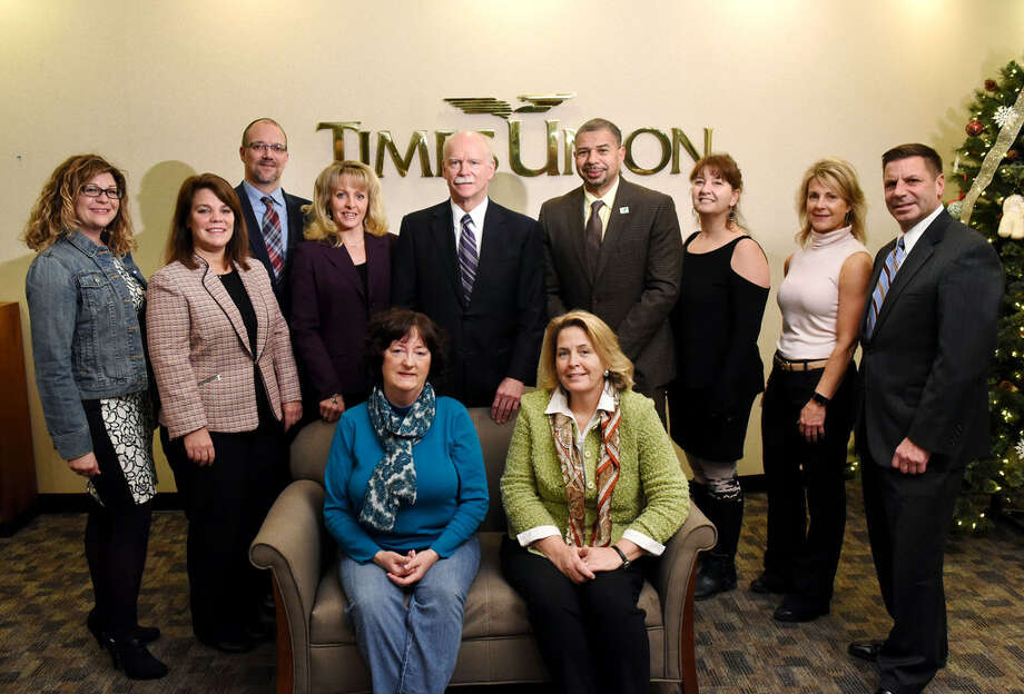 "George R. Hearst III, center, poses with representatives from local nonprofits who won the Times Union's ""The Big $100,000 Giveaway"" on Tuesday, Dec. 12, 2017, at the Times Union in Colonie, N.Y. Pictured left to right in the back row; Kat Brown of Trinity Alliance, Bonnie St. Onge of Interfaith Partnership for the Homeless, Todd Cramer of Mohawk Hudson Humane Society, Jeannine Garab of Northeastern New York Epilepsy Foundation, David Brown of Capital District YMCA, Tracie Keeler of South End Children's Cafe, Denise Nicastro of JDRF Northeastern New York and Peter Semenza of St. Peter's Hospital ALS Center. Seated: Barbara Carroll of Whiskers Animal Benevolent League, left, and Diane Conroy-LaCivita of Colonie Senior Services. (Will Waldron/Times Union)"