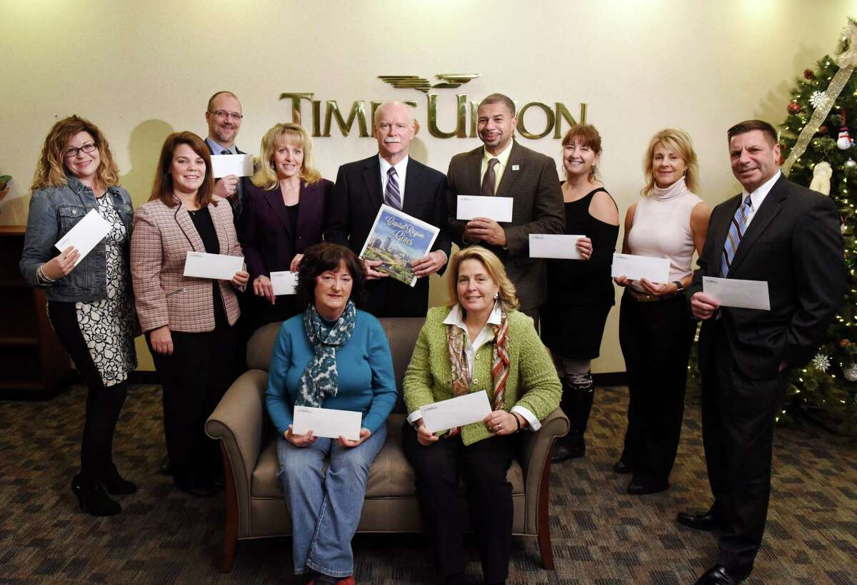 George Hearst III, center, stands for a group photo with Capital Region not-for-profit organization senior representatives who shared in the Times Union's $100,000 Giveaway contest on Tuesday, Dec. 13, 2017, at the Times Union in Colonie, N.Y. Pictured left to right in the back row are; Kat Brown of Trinity Alliance, Bonnie St. Onge of Interfaith Partnership for the Homeless, Todd Cramer of Mohawk Hudson Humane Society, Jeannine Garab of Northeastern New York Epilepsy Foundation, David Brown of Capital District YMCA, Tracie Keeler of South End Children's Cafe, Denise Nicastro of JDRF Northeastern New York and Peter Semenza of St. Peter's Hospital ALS Center. Seated are ; Barbara Carroll of Whiskers Animal Benevolent League, left, and Diane Conroy-LaCivita of Colonie Senior Services, right. (Will Waldron/Times Union)