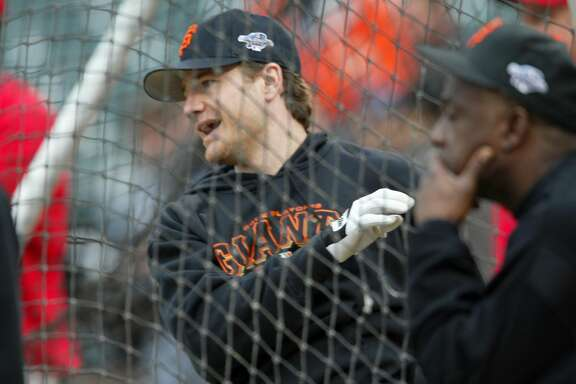 GIANTS-C-22OCT02-SP-BW.jpg---Giants David Bell takes batting practice as batting coach Gene Clines keeps a watchful eye. The San Francisco Giants play the Anaheim Angels in Game 3 of the World Series at Pac Bell Park in San Francisco, Ca., October 22, 2002. Brant Ward/San Francisco Chronicle