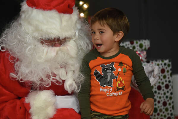 Jett Rios, age 4, talks to Santa during a Christmas party for Centers clients Wednesday, Dec. 13, 2017, at the Junior League of Midland. James Durbin/Reporter-Telegram