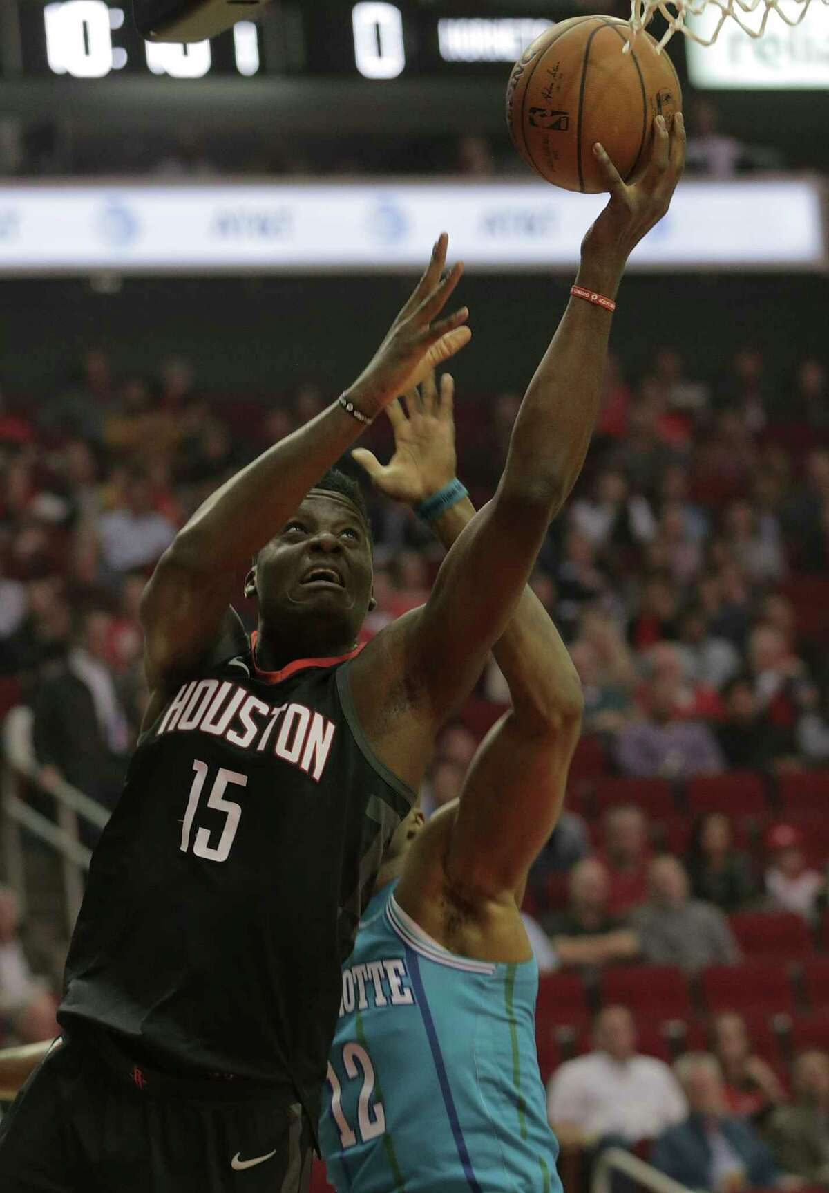 Houston Rockets center Clint Capela (15) drives to the basket around Charlotte Hornets center Dwight Howard (12) in the first quarter at the Toyota Center on Wednesday, Dec. 13, 2017, in Houston.