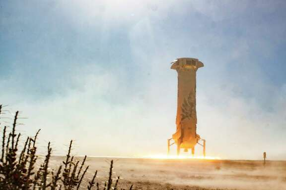 In this photo provided by Blue Origin, the New Shepard booster lands in west Texas during a test on Tuesday, Dec. 12, 2017. Named after the first American in space, Alan Shepard, the spacecraft made a 10-minute suborbital flight. (Blue Origin via AP)