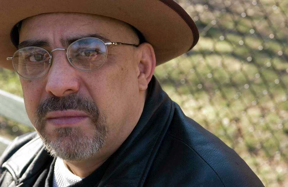 FILE - In this Feb. 3, 2007, file photo, Pat DiNizio of Smithereens poses for a photograph in New York. DiNizio, lead singer and songwriter of the New Jersey rock band died at age 62. The band announced on Facebook that DiNizio died Tuesday, Dec. 12, 2017.  (AP Photo/Jim Cooper, FIle) ORG XMIT: NYAG301 Photo: Jim Cooper / AP2007