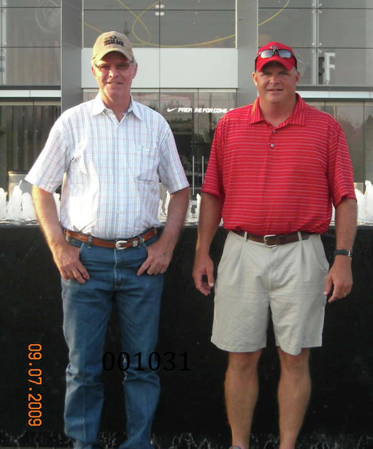 Douglas Hudson, left in white, with his son, Cade Hudson, who is a plaintiff in the wrongful death suit about his father's heat death at the Gurney Unit in July 2011.