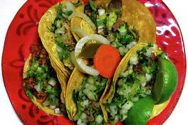Tacos of the Week: $1 street tacos with asada, lengua, carnitas, pastor and cabeza on doubled-up corn tortillas with onions, cilantro, limes and escabeche from Tacos La Salsita truck.