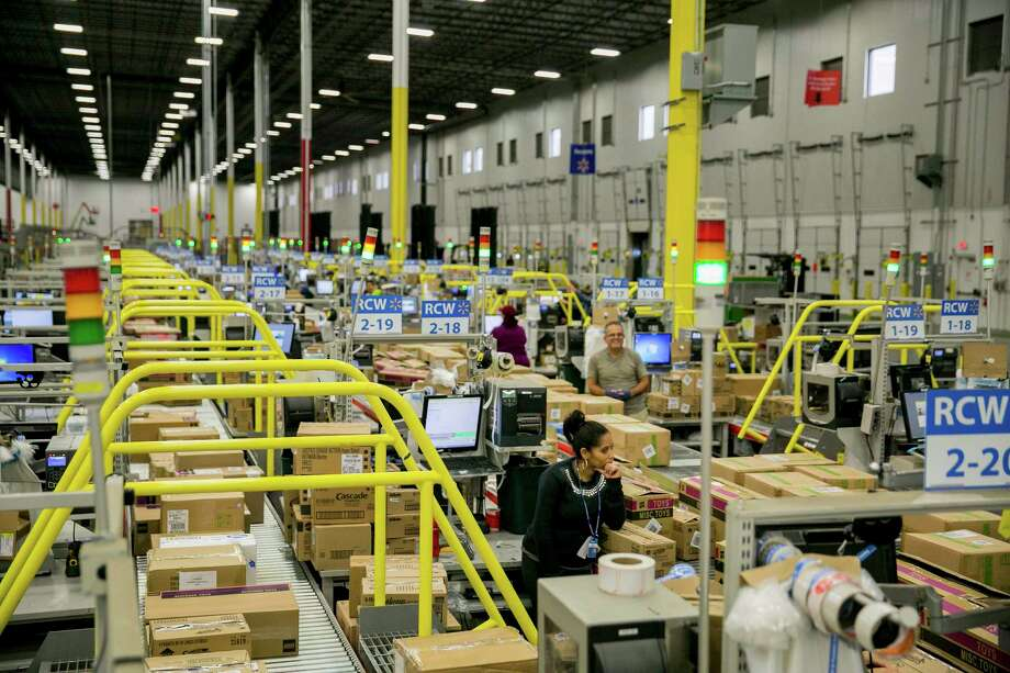 Walmart operates this fulfillment center in Bethlehem, Pa. Walmart has started offering payday advances - not loans - to employees through an app called Even, but some critics of the retailer's labor practices say it should raise wages instead. Photo: SAM HODGSON, STR / NYTNS