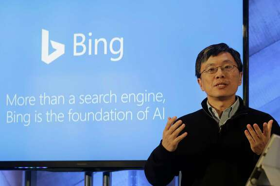 Harry Shum, executive vice president of Microsoft's Artificial Intelligence and Research, speaks at a Microsoft event in San Francisco, Wednesday, Dec. 13, 2017. Microsoft rolled out new features on its Bing search engine powered by artificial intelligence, including one that summarizes the two opposing sides of contentious questions, and another that measures how many reputable sources are behind a given answer. (AP Photo/Jeff Chiu)