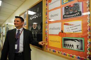 Shelton Intermediate School Headmaster Kenneth Saranich by the school's Word Wall in Shelton, Conn. on Tuesday, October 11, 2016. The school district celebrates a word of the week, which teachers use throughout the week in all areas of the school's curriculum. The school introduces students to two vocabulary words each week, the district word on Monday and a second word on Thursday.