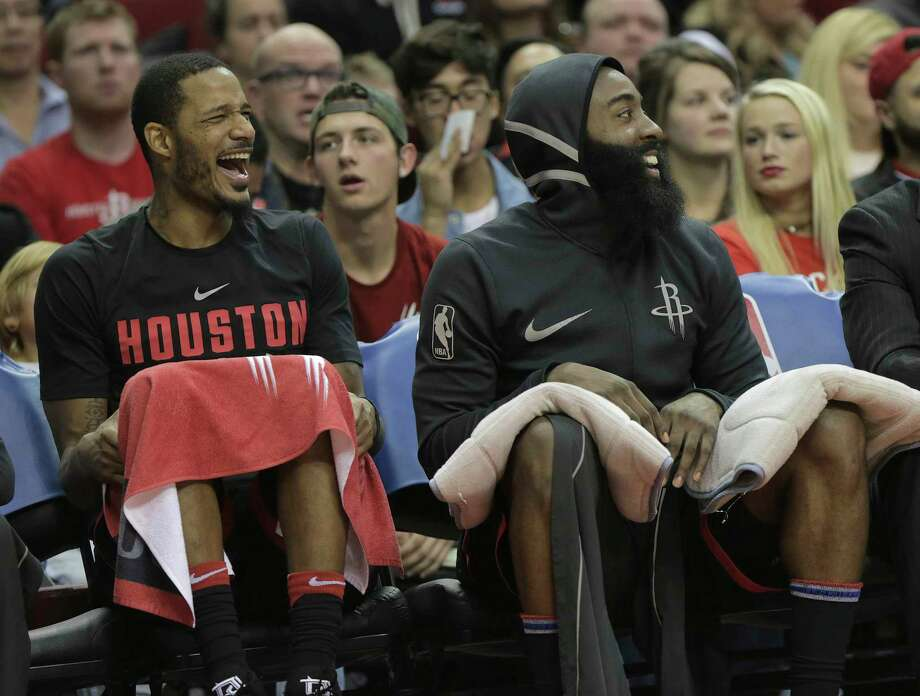 Houston Rockets forward Trevor Ariza (1) and Houston Rockets guard James Harden (13) laugh while sitting on the bench in the fourth quarter against the Charlotte Hornets at the Toyota Center on Wednesday, Dec. 13, 2017, in Houston. Rockets won the game 108-96. Photo: Elizabeth Conley, Houston Chronicle / © 2017 Houston Chronicle