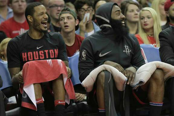 Houston Rockets forward Trevor Ariza (1) and Houston Rockets guard James Harden (13) laugh while sitting on the bench in the fourth quarter against the Charlotte Hornets at the Toyota Center on Wednesday, Dec. 13, 2017, in Houston. Rockets won the game 108-96.