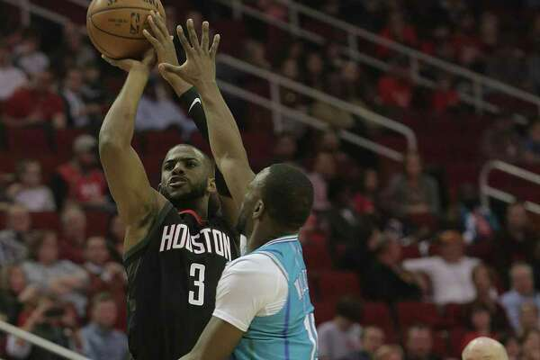 Rockets guard Chris Paul puts up a shot in the first quarter against the Hornets at Toyota Center on Wednesday night as the Rockets improved to a league-leading 22-4. Paul had game highs of 31 points and 11 assists.