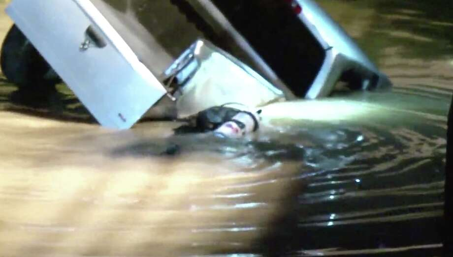 Harris County first responders were searching for the driver of a vehicle that lost control and flipped over the bridge into South Mayde Creek Wednesday night. Photo: Metro Video