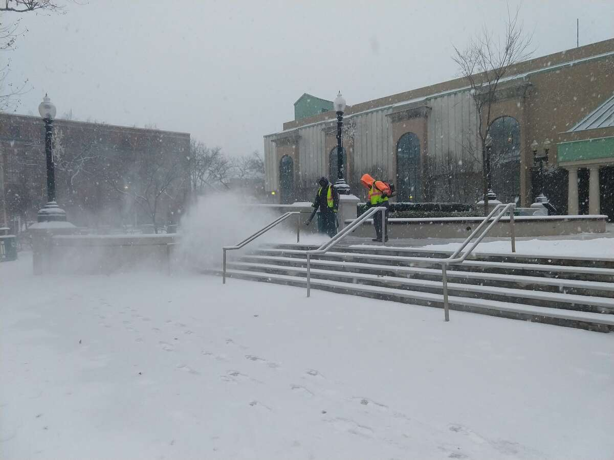 City workers clear snow outside the Margaret E. Morton Government Center in Bridgeport Thursday, Dec. 14, 2017.