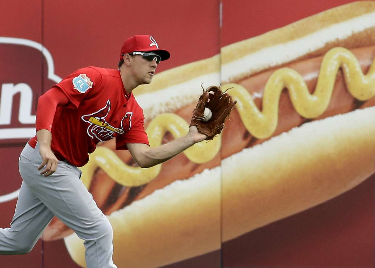 St. Louis Cardinals right fielder Stephen Piscotty catches a ball hit by Miami Marlins' J.T. Realmuto to end the third inning of an exhibition spring training baseball game Saturday, March 5, 2016, in Jupiter, Fla. He was traded to the Oakland A's on Thursday.