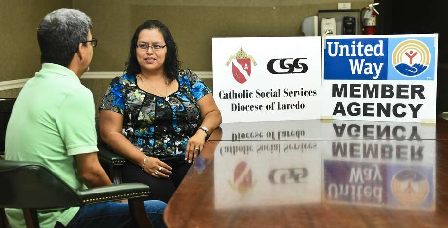 Executive Director for Catholic Social Services, Rachel Flores, speaks with a person in need of assistance on Thursday, July 6, 2017 at the Catholic Social Services office. Photo: Danny Zaragoza