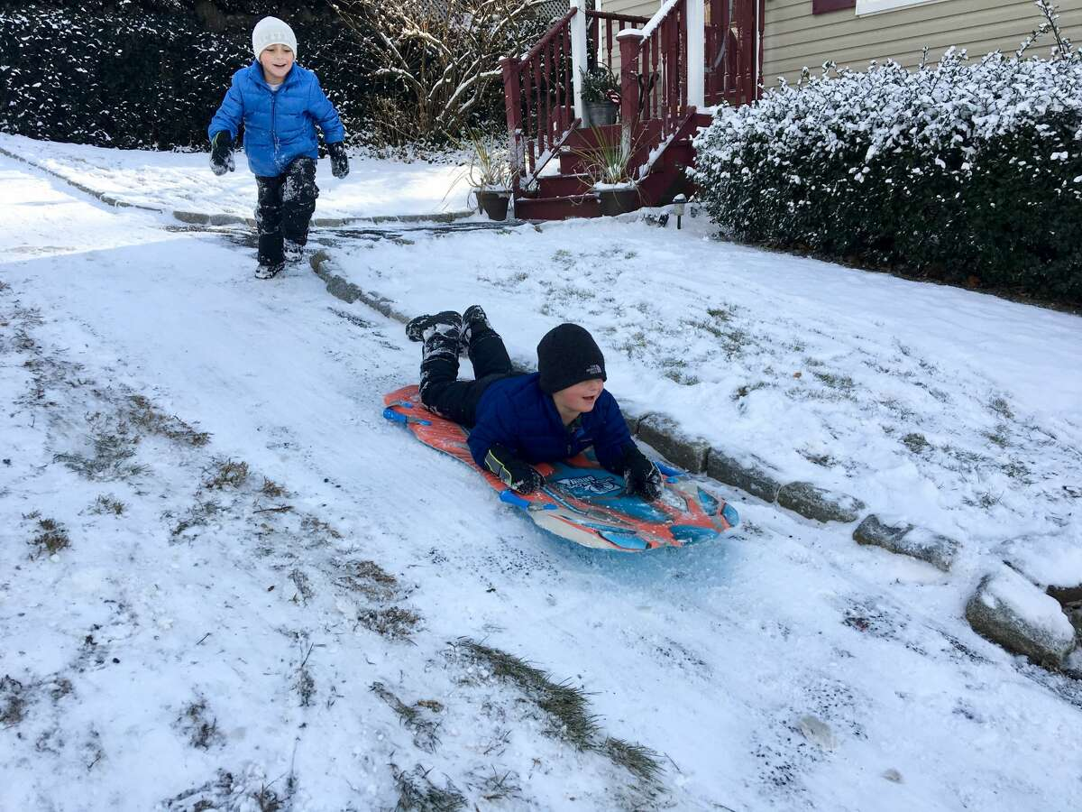 Kids play in the snow in the Byram section of Greenwich on Thursday, Dec. 14, 2017.