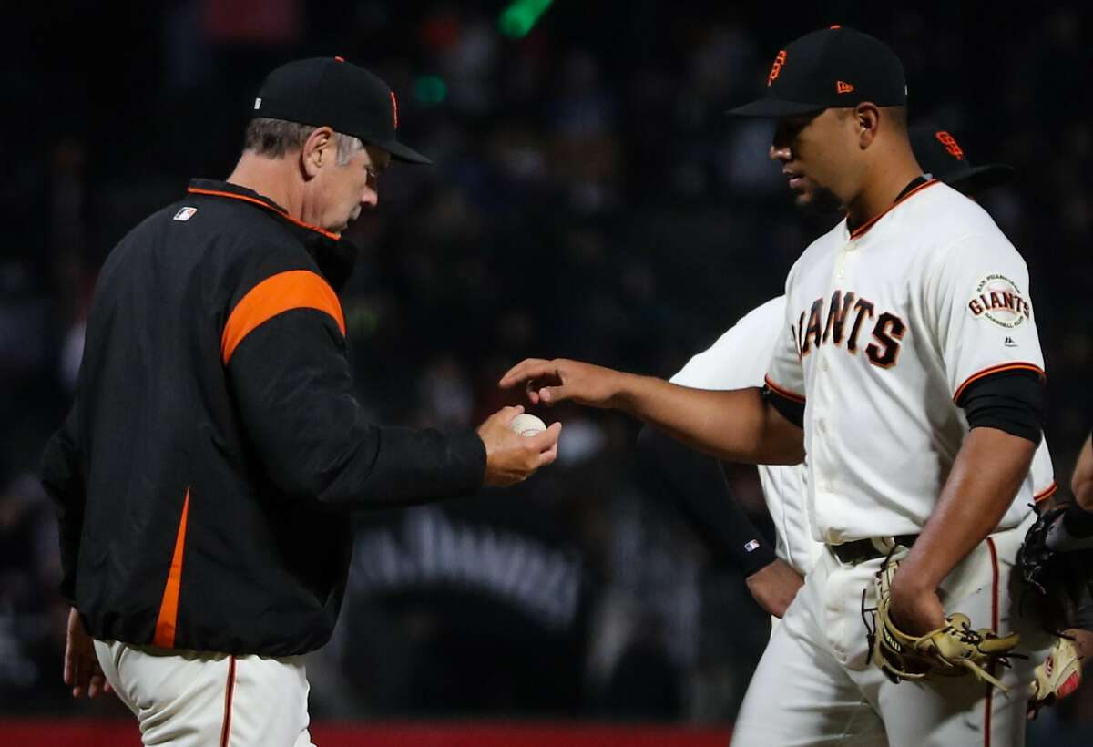 Giants' manager Bruch Bochy (15) takes pitcher Albert Sua‡rez (56) out of the game during a game between the San Francisco Giants and the Milwaukee Brewers at AT&T Park in San Francisco, Calif., on Tuesday, Aug. 22, 2017. The Giants lost Suarez to the Rockies in the Rule 5 draft.
