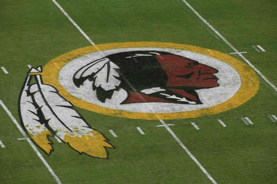 FILE - In this Aug. 7, 2014 file photo, the Washington Redskins logo is seen on the field before an NFL football preseason game against the New England Patriots in Landover, Md.On Wednesday,Rising Hearts Coalition, a native advocacy group out of Washington D.C., pushed an elaborate online hoax to introduce the Washington Redskins' new mascot as the 'Washington Redhawks.' Photo: Alex Brandon, AP / AP
