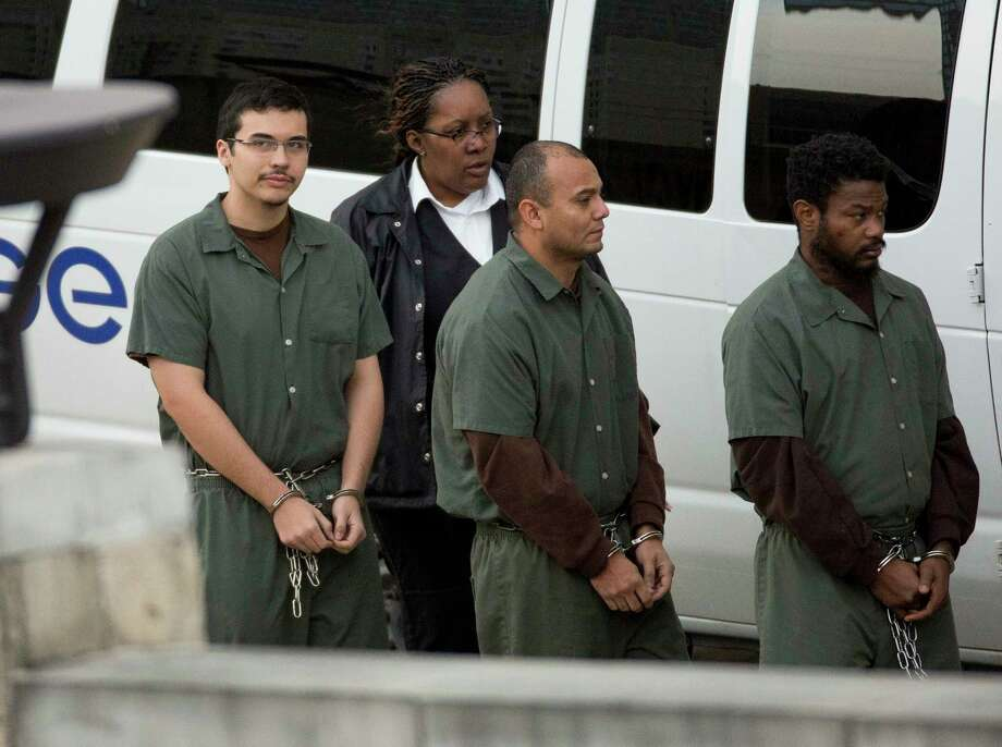 Eighteen-year-old Kaan Sercan Damlarkaya, left, is taken to Federal Court on Thursday, Dec. 14, 2017, in Houston. Damlarkaya is appearing in federal court on allegations he supported ISIS and hoped to die a martyr for the cause. Photo: Godofredo A. Vasquez, Houston Chronicle / Godofredo A. Vasquez