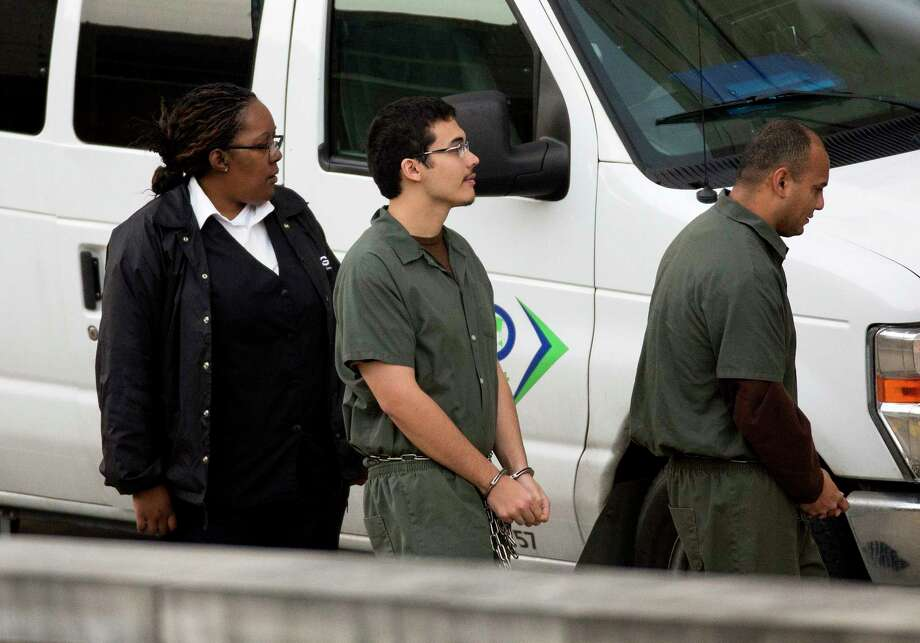 Eighteen-year-old Kaan Sercan Damlarkaya, center, is brought in for hearing at the Federal Court Thursday, Dec. 14, 2017, in Houston. Damlarkaya is appearing in federal court on allegations he supported ISIS and hoped to die a martyr for the cause. Photo: Godofredo A. Vasquez, Houston Chronicle / Godofredo A. Vasquez