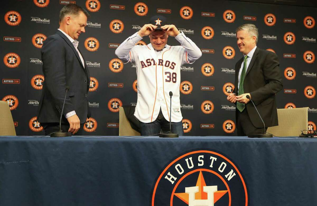 The Houston Astros AJ Hinch and Jeff Luhnow introduced relief pitcher and free-agent signee Joe Smith Thursday, Dec. 14, 2017, in Houston.