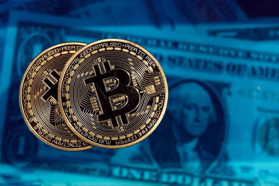 Bitcoins are basically lines of computer code that are digitally signed each time they travel from one owner to the next. Transactions can be made anonymously, making the currency popular with libertarians as well as tech enthusiasts, speculators — and criminals. Photo: Chris Ratcliffe, Bloomberg
