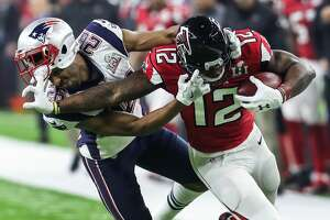 New England Patriots cornerback Logan Ryan (26) has his facemask pushed back as he stops Atlanta Falcons wide receiver Mohamed Sanu (12) on a 9-yard reception during the fourth quarter of Super Bowl LI at NRG Stadium on Sunday, Feb. 5, 2017, in Houston.