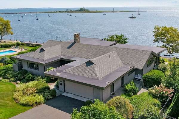 "The sweeping views of Long Island Sound are the crown jewel of the 2,806 square foot house at 105 Battery Park Drive in Bridgeport's Black Rock section. The water can be glimpsed from nearly every room of the two-bedroom, three bathroom house, and the entire back of the main living space is windowed, creating a frame for the sound. The current owner is retired actress Kathryn Hays, who spent more than 38 years on the soap opera ""As the World Turns. The house is listed at $899,900."