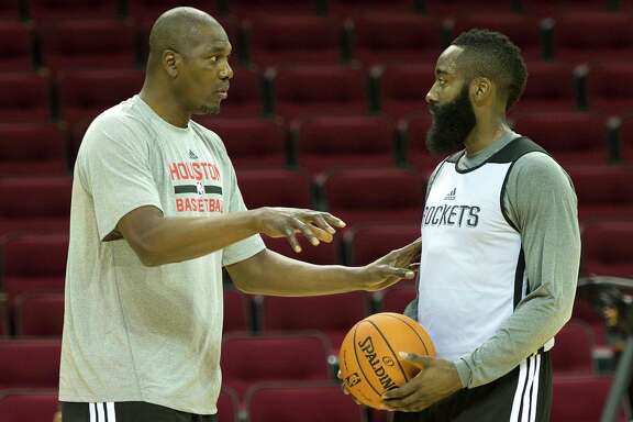 Hakeem Olajuwon works works with Houston Rockets shooting guard James Harden during the first practice of the team's preseason training camp at Toyota Center on Saturday, Sept. 28, 2013, in Houston. ( Smiley N. Pool / Houston Chronicle )