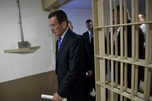 Gov. Dannel P. Malloy, shown here in a 2015 visit to the Hartford Correctional Center, has led efforts to divert non-violent offenders from prison. The inmate population reached a 23-year low on Thursday.