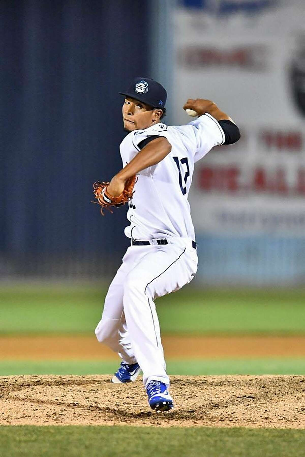 Asheville Tourists pitcher Julian Fernandez (22) delivers a pitch during a game against the Greensboro Grasshoppers at McCormick Field on April 28, 2017 in Asheville, North Carolina. The former Rockies prospect was selected by the Giants in the Rule 5 draft.