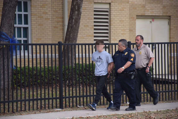 Police have detained a suspect following the lockdown of Travis Early College High School Thursday morning, Dec. 14, 2017. A student had received threatening text messages from her boyfriend, according to a San Antonio ISD official.