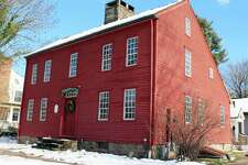 Visitors to the Bates-Scofield Home in Darien Dec. 10 experienced tours given by student docents.