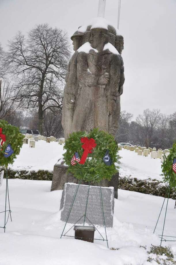 Ceremonial Wreaths surround Karl Lang Monument at Spring Grove Cemetery in Darien, Conn. Photo: Contributed Photo / Contributed Photo / Darien News contributed