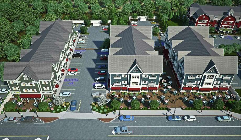 An aerial-view rendering of Brookfield Village, a multi-use development under construction in the Four Corners area of Brookfield, Conn. Phase I, which includes the buildings on the left and in the back, is nearing completion with Phase II ready to break ground in early 2018. Photo: Contributed Rendering / Hearst Connecticut Media / The News-Times Contributed