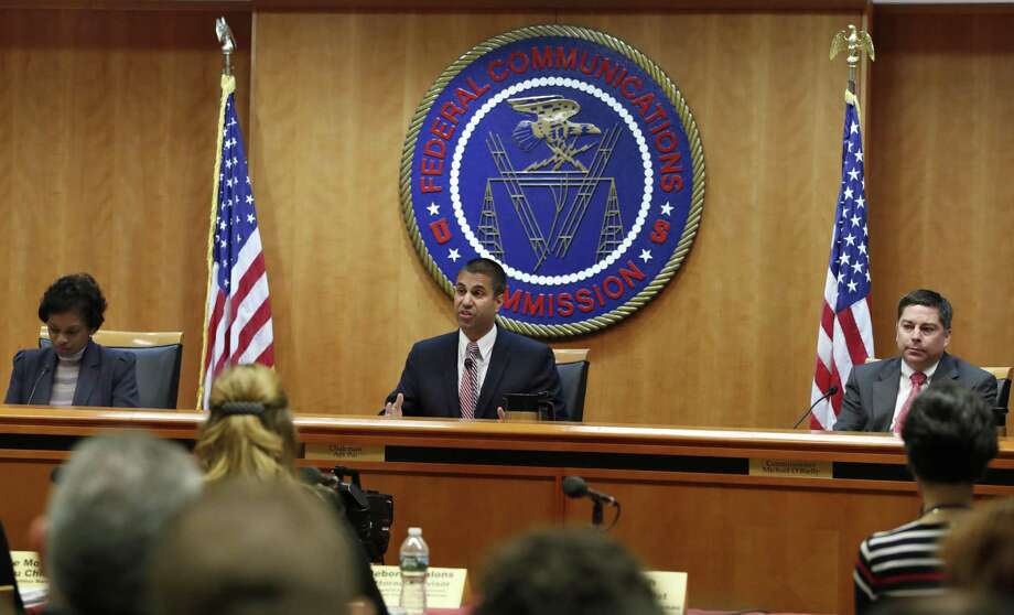 Federal Communications Commission (FCC) Chairman Ajit Pai, center, announces the vote was approved to repeal net neutrality, next to Commissioner Mignon Clyburn, left, who voted no, and Commissioner Michael O'Rielly, who voted yes, at the FCC, Thursday, Dec. 14, 2017, in Washington. (AP Photo/Jacquelyn Martin) Photo: Jacquelyn Martin / Associated Press / Copyright 2017 The Associated Press. All rights reserved.