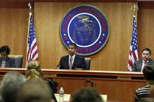 Federal Communications Commission (FCC) Chairman Ajit Pai, center, announces the vote was approved to repeal net neutrality, next to Commissioner Mignon Clyburn, left, who voted no, and Commissioner Michael O'Rielly, who voted yes, at the FCC, Thursday, Dec. 14, 2017, in Washington. (AP Photo/Jacquelyn Martin)
