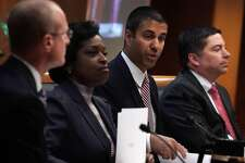 WASHINGTON, DC - DECEMBER 14:  Federal Communications Commission Chairman Ajit Pai speaks as commission members (L-R) Brendan Carr, Mignon Clyburn, Michael O'Rielly listen during a commission meeting December 14, 2017 in Washington, DC. FCC has voted to repeal its net neutrality rules at the meeting. (Photo by Alex Wong/Getty Images)