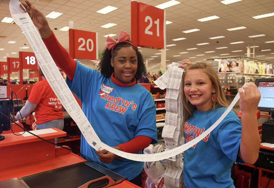 "Target Supvervisor Hardlines TL Markeisha Williams, left, and Kirstyn Jackson, 12, a 7th grader at Schindewolf Intermediate and former foster child, check out the receipt totals after day two of ""Kirstyn's Krew""'s annual Target shopping spree for Klein ISD students in foster care at the Target store at 19511 I-H 45 South in Spring on Dec. 13, 2017. (Photo by Jerry Baker/Freelance) Photo: Jerry Baker, Freelance / Freelance"